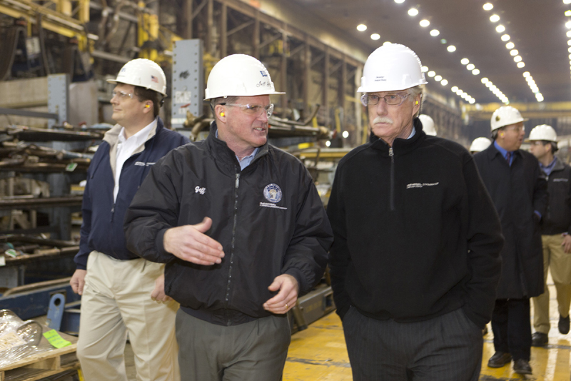 Bath Iron Works president Jeff Geiger talks with Sen. Angus King Thursday, as King and Sen. Susan Collins toured the shipbuilding plant.