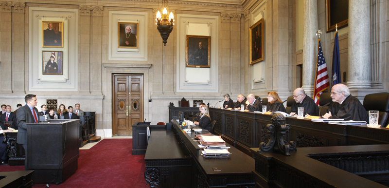 Assistant District Attorney Patrick Gordon takes questions from justices of the Maine Supreme Judicial Court in Portland on Wednesday. The court heard oral arguments in the appeal by prosecutors the dismissal of invasion of privacy charges against Mark Strong, Sr.