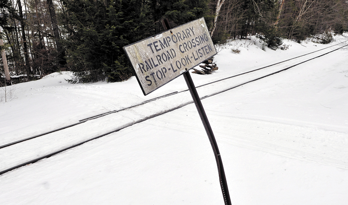 Snow covers the railroad crossing on Dustin Drive in Belgrade Tuesday. PanAm Railways is planning a rate hike for maintenance on private railroad crossings like this one.
