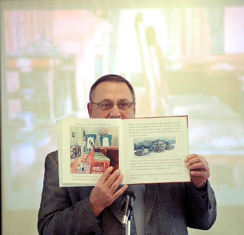 Gov. Paul LePage reads