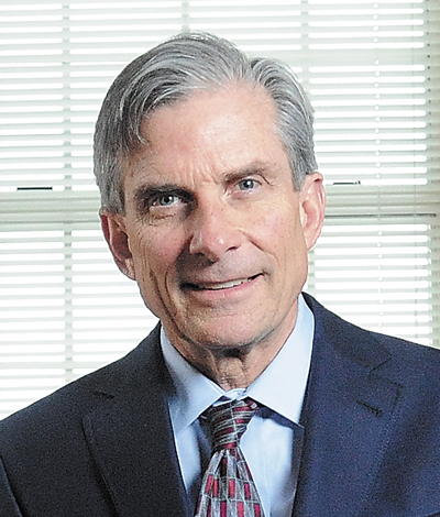William D. Adams, president of Colby College
