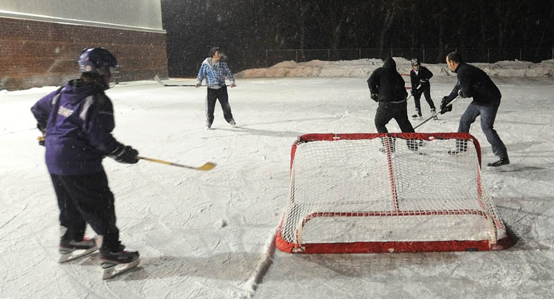 Kids play hockey at the ice rink at the Alfond Youth Center on North Street in Waterville in January.