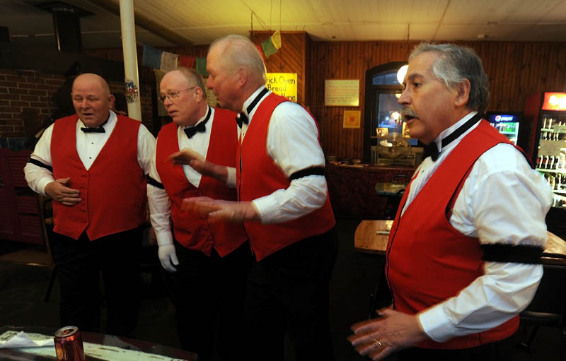 Barber shop quartet Buck and a Quarter performs at Grand Central Cafe at Railroad Square in Waterville Wednesday night.