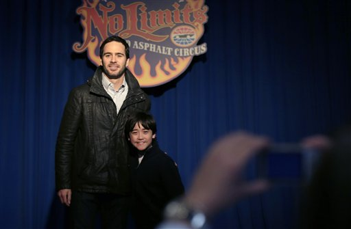 NASCAR driver Jimmie Johnson, left, poses for a photo with racing fan Sam Valenti, 10, during an event at the House of Blues in Dallas, Wednesday, Feb. 27, 2013. Johnson's whirlwind week as Daytona 500 champion continues with an appearance in downtown Dallas. It will be the third state and second time zone Johnson has visited since Sunday's win, and he has to race this weekend in Phoenix. (AP Photo/LM Otero)