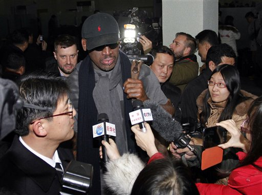 Flamboyant former NBA star Dennis Rodman is surrounded by journalists upon arrival at Pyongyang Airport, North Korea, on Tuesday.