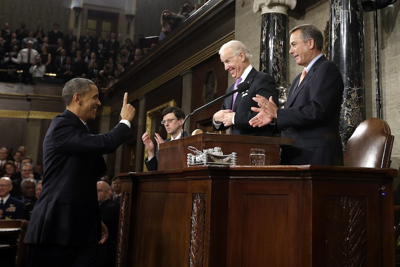 President Barack Obama gestures toward Vice President Joe Biden and House Speaker John Boehner of Ohio before giving his State of the Union address during a joint session of Congress on Capitol Hill in Washington, Tuesday Feb. 12, 2013. (AP Photo/Charles Dharapak, Pool) US Capitol