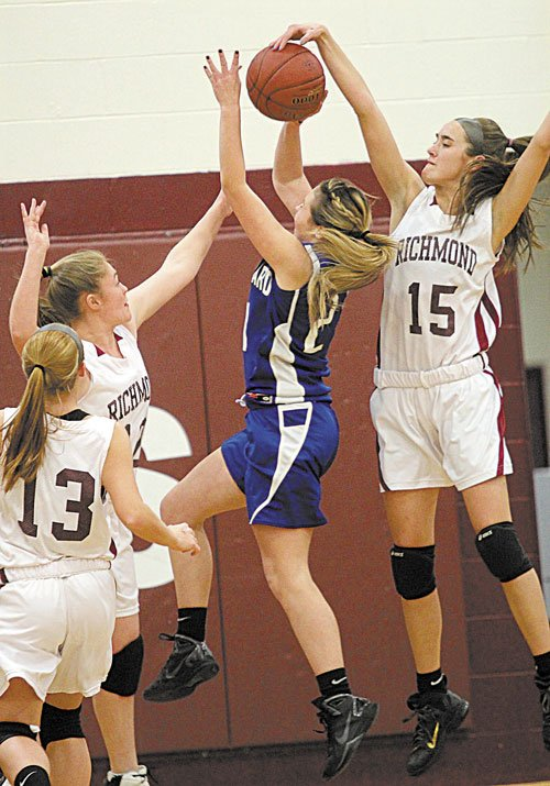 BLOCKING IT: Richmond High School's Jamie Plummer blocks a shot by Old Orchard Beach's Abby Dubois with help from teammate Brianna Snedeker, left, as Noell Acord (13) looks on during the first half Tuesday night in Richmond.