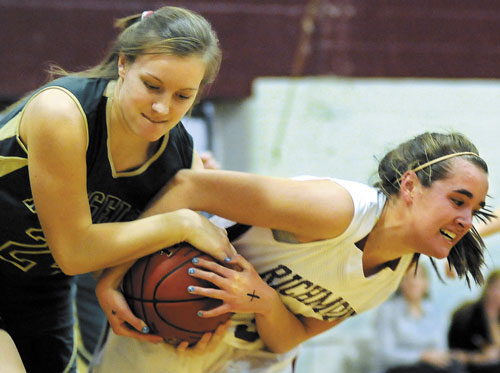 GIVE IT TO ME: Richmond's Jamie Plummer, right, pulls the ball away from Rangeley's Jenney Abbott in an earlier game. The Bobcats and the Lakers are on a collision course in the Western Class D tournament.
