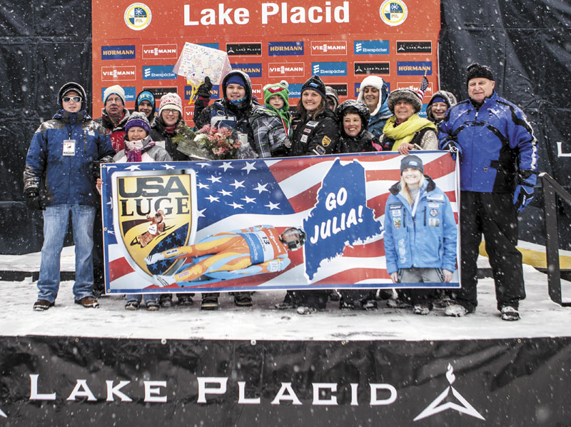 FAMILY AFFAIR: Julia Clukey, center, poses with family and friends after earning her first podium finish in a World Cup luge race Friday in Lake Placid, N.Y. Clukey finished second Friday, just .295 seconds behind Germany's Natalie Geisenberger.
