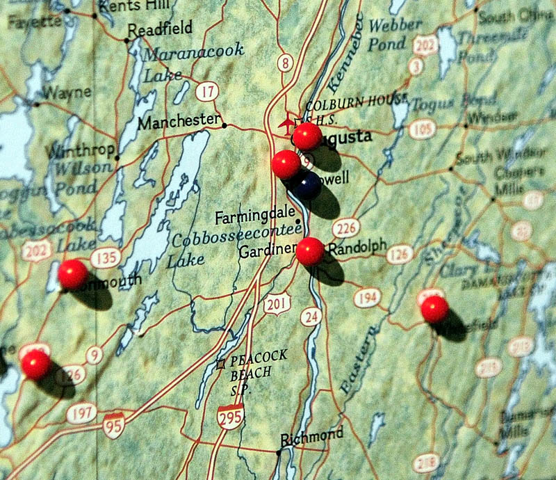Pins on the map mark cities and towns that passed resolutions opposing the state budget during a Maine People's Alliance event on Tuesday.