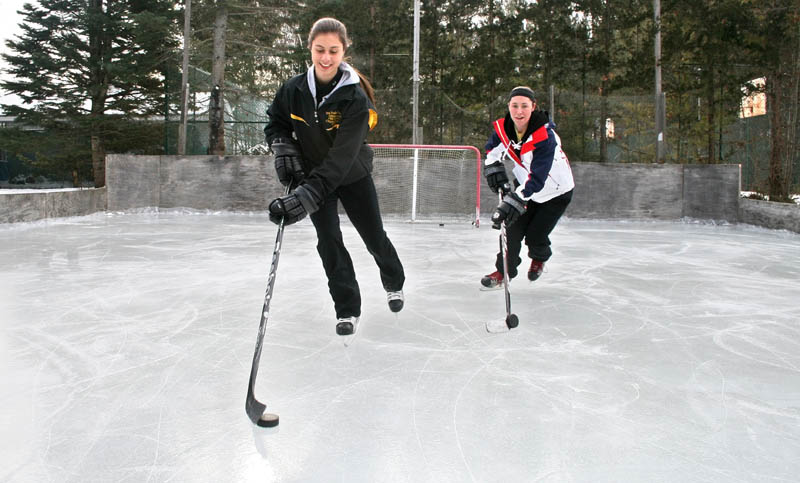 Jena Nawfel, left, and her friend Anne-Marie Provencal at Nawfel's home rink in Waterville.