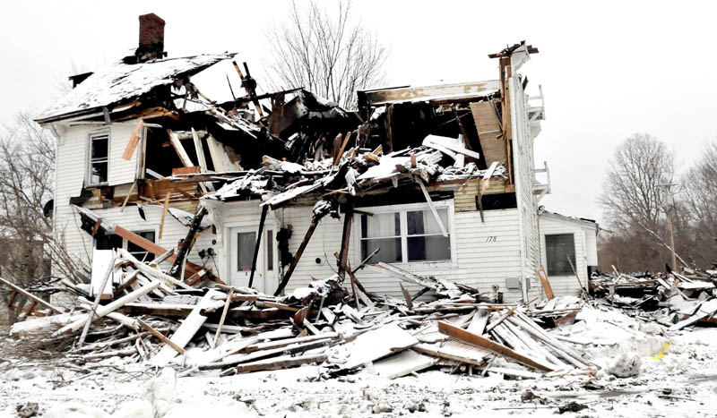 The remains of an apartment building that was destroyed by fire on Saturday, at 178 Main Street in Unity, as seen on Sunday. Four tenants are homeless and firefighters from 14 departments battled the stubborn fire Saturday morning and into the night.