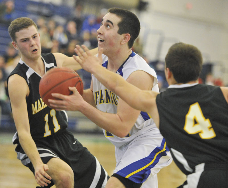TO THE HOOP: Falmouth's Thomas Coyne drives to the basket by Maranacook's Taylor Wilbur, left, during a Western B quarterfinal game in Portland.