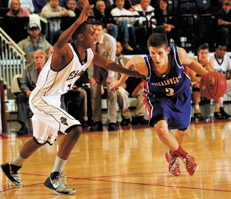 Messalonskee's Jordan Holmes, right, dribbles past Edward Little's Mahad Mohamed during an Eastern Class A tournament game on Saturday February 16, 2013 at the Augusta Civic Center.