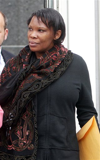 In this April 12, 2012 file photo, Beatrice Munyenyezi leaves the federal courthouse in Concord, N.H., after a mistrial in a case on whether she lied about her role in the 1994 Rwanda genocide to obtain U.S. citizenship. On Thursday Feb. 21, 2013 a jury convicted Munyenyezi of lying about Rwanda genocide to get U.S. citizenship. U.S. District Judge Steven McAuliffe stripped her of her citizenship and ordered her detained until her sentencing, scheduled for June 3. Her lawyers said they will appeal. (AP Photo/Jim Cole)