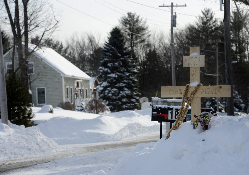 A makeshift memorial stands across from 17 Sokokis Road in Biddeford, where Derrick Thompson and Alivia Welch were shot dead, in this December 2012 file photo.