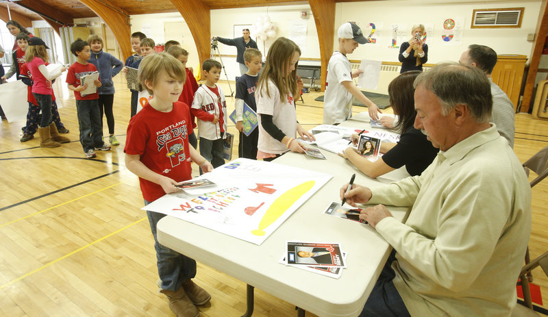 St. Brigid's School pupils line up for autographs from Jerry Remy, Jenny Dell and Don Orsillo on Thursday when NESN's team of Red Sox announcers brought their offseason road show to Portland as part of their preseason promotion.