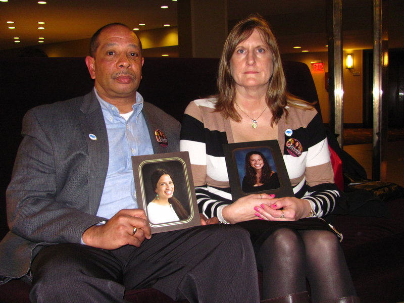Wayne and Judi Richardson hold pictures of their daughter, Darien, who died in 2010 after being shot by an intruder at her Portland apartment. The Richardsons were in Washington, D.C., last week to lobby for gun law reform.