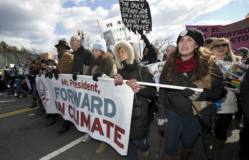 From center to right, Bill McKibben (wearing glasses), Fiona McRaith, Leah Qusba and Maayan Cohen join a march from the National Mall to the White House on Sunday during a rally calling on President Obama to reject the Keystone XL oil pipeline from Canada.