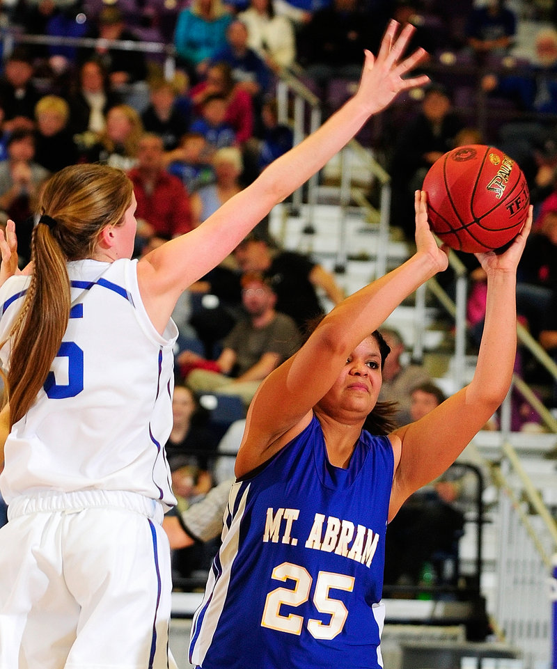 Annie Dexter of Mt. Abram looks for a teammate while keeping the ball from Bronte Elias of Madison in Madison's 50-42 victory in a Western Class C quarterfinal.