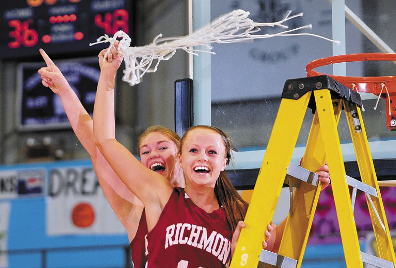 Richmond captains Brianna Snedeker, left, and Noell Acord celebrate after their team won its third straight Western Class D girls' basketball championship, beating top-seeded Rangeley 48-36 at the Augusta Civic Center.