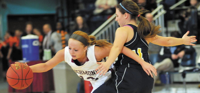 Richmond's Noell Acord, left, collides with Hyde's Shannon Ward in a Western Class D semifinal Thursday at the Augusta Civic Center. Richmond advanced to the regional final with a 43-36 victory.
