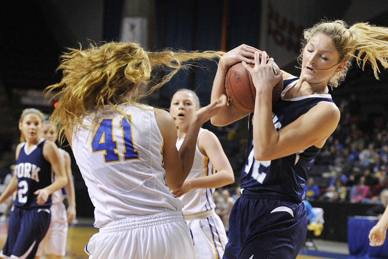 York's Emily Campbell wrestles the ball away from Lake Region's Kelsey Winslow during the Western Class B final Saturday. Lake Region won, 50-24. The Lakers will face Eastern champion Presque Isle for the state championship on Friday.
