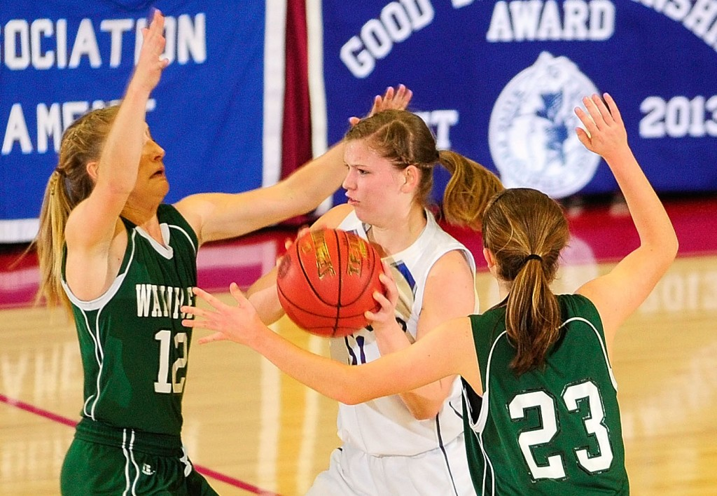 Madison junior guard Kirstin Wood, middle, is double teamed by Waynflete defenders Martha Veroneau, left, and Leigh Fernandez during the Western Maine Class C girls championship game on Saturday at the Augusta Civic Center.