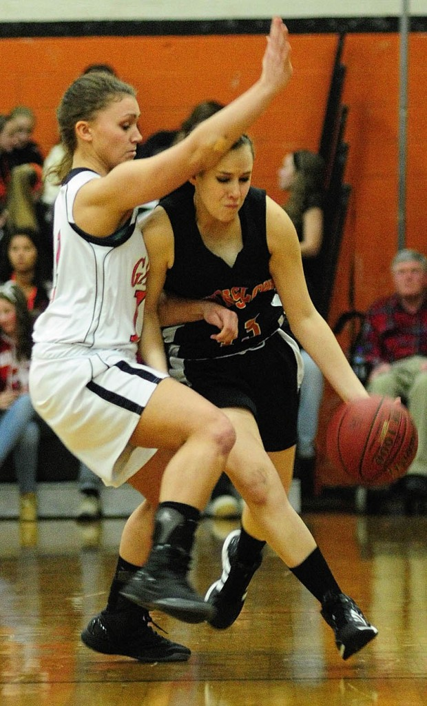 TIGHT DEFENSE: Gardiner's Taylor Banister, left, tries to stop a drive by Winslow's Alyssa Wood during an Eastern Class B preliminary game Tuesday in John A. Bragoli Memorial Gym at Gardiner Area High School.
