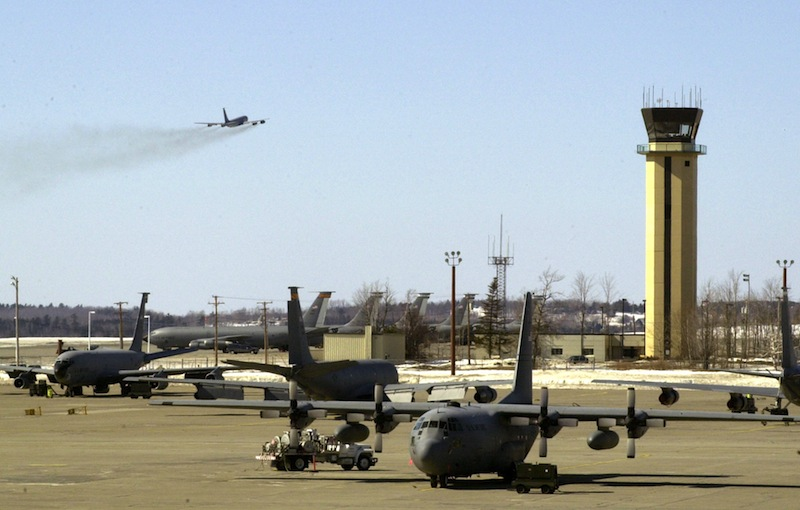In this 2003 file photo, a KC-135 refueling tanker takes off at Bangor International Airport as other planes sit below the airport control tower. Bangor International Airport got preliminary word that its air traffic control tower may continue operating 24 hours a day until July as the Federal Aviation Administration decides how to implement spending cuts. John Patriquin