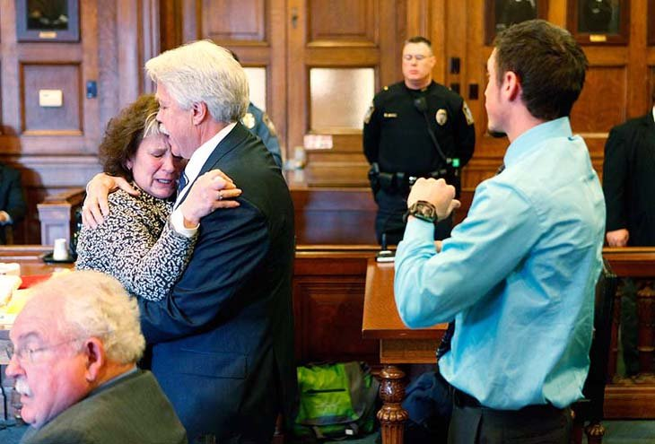 Mark Strong Sr. comforts his wife Julie after she became emotional while addressing Justice Nancy Mills during Strong's sentencing at Cumberland County Superior Court in Portland on Thursday.