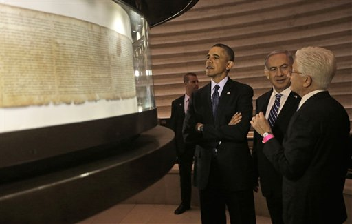 US President Barack Obama, 3rd right, views the Dead Sea Scrolls with Israeli Prime Minister Benjamin Netanyahu, 2nd right, and Director of the Museum, James Snyder, far right at the Israel Museum in Jerusalem, Israel, Thursday, March 21, 2013. After a visit to Israel's national museum to inspect the Dead Sea Scrolls, which highlight the Jewish people's ancient connection to the land that is now Israel, Obama headed to the West Bank to tell the Palestinians that the creation of a Palestinian state remains a priority for his administration. (AP Photo/Pablo Martinez Monsivais)