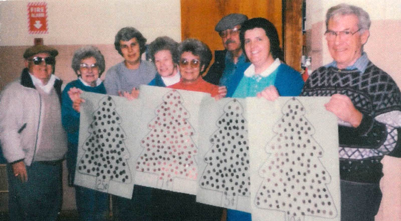 Interfaith Food Pantry volunteers in 1998, including Herbert Scribner, far right, whose son, Mark, contributed $25,000 to the organization in his father's honor. The others in the group, from left, are Bill Nye, Marie Nye, Nancy Marcoux, Marcel Donahue, Juliette Gauthier, Dick Tompkins and Suzie Caverley.