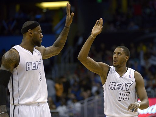 Miami Heat guard Mario Chalmers (15) is congratulated LeBron James (6) during the second half of an NBA basketball game against the Orlando Magic on Monday in Orlando, Fla. The Heat won 108-94 to stretch their winning streak to 27 games.