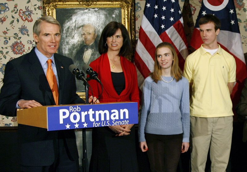 U.S. Sen. Rob Portman, from left, with his wife, Jane, daughter Sally, and son Will, after announcing that he will run for the U.S. Senate, in Lebanon, Ohio. Portman is now supporting gay marriage and says his reversal on the issue began when he learned his son Will is gay.