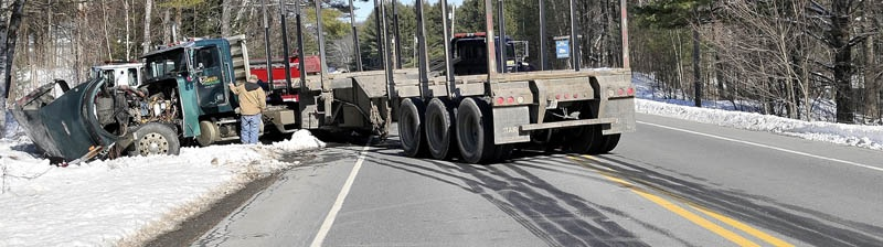 A logging truck involved in a collision with an SUV on US Route 2 also known as Canaan Road sits in the ditch with in Skowhegan Thursday. No serious injuries were reported.