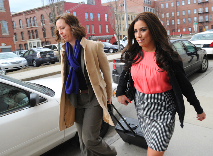 Alexis Wright and her attorney, Sarah Churchill, arrive at the Cumberland County Courthouse in Portland on Friday.