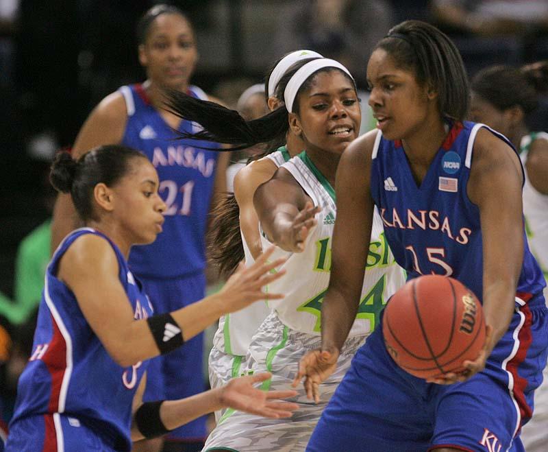 Kansas' Chelsea Gardner, 15, passes the ball to Angel Goodrich as Notre Dame's Ariel Braker pressures in Sunday's NCAA women's basketball regional semifinal at Norfolk, Va.