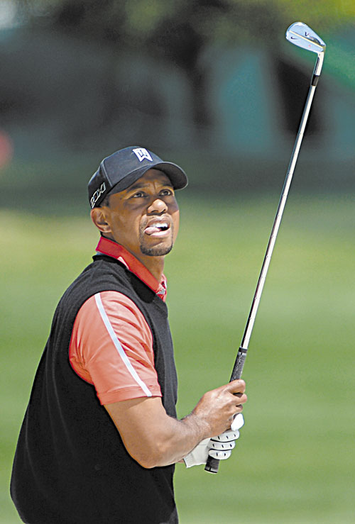 WINNER: Tiger Woods watches his bunker shot at the 16th hole during the final round of the Arnold Palmer Invitational on Monday in Orlando, Fla.