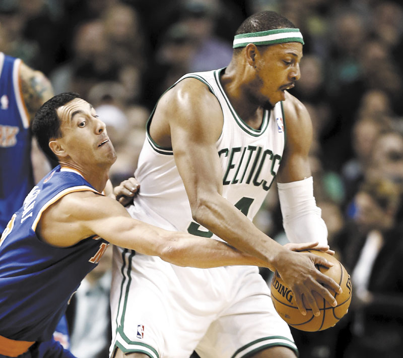 BEHIND YOU: New York's Pablo Prigioni, left, tries to steal the ball from Boston's Paul Pierce during the first quarter of their game Tuesday in Boston.