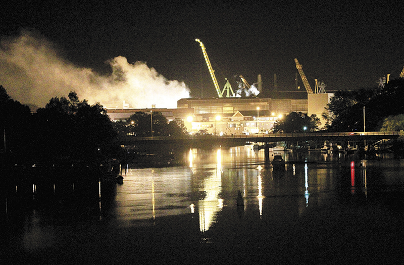 Smoke rises from a Portsmouth Naval Shipyard dry dock as fire crews respond Wednesday, May 23, 2012, to a fire on the USS Miami SSN 755 submarine at the Portsmouth Naval Shipyard on an island in Kittery, N.H. Four people were injured.