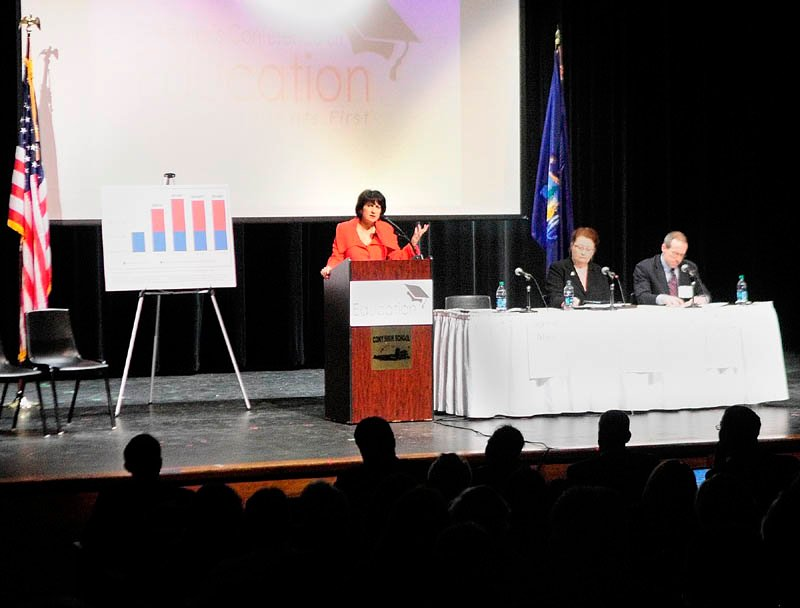 Staff photo by Joe Phelan Jeanne Allen, president of the Center for Education Reform, standing right, speaks during Governor�s Conference on Education: Putting Students First on Friday March 22, 2013 at Cony High School in Augusta.