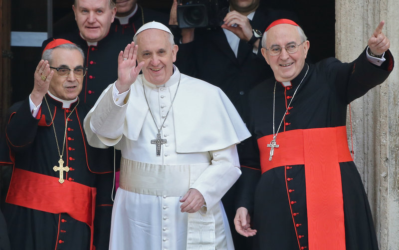 Pope Francis waves from the steps of the Santa Maria Maggiore Basilica in Rome Thursday. At left is Cardinal Santos Abril of Spain and, right, Cardinal Agostino Vallini, Vicar General of Rome.