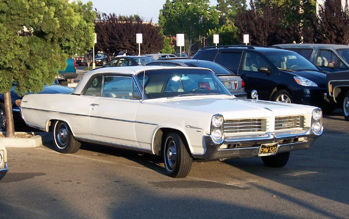 A white, 1964 Pontiac Catalina 2-door hardtop at the weekly Garden Grove, Calif. car show on July 23, 2004. Amy Calder's first car was a white Pontiac Catalina that would overheat if she drove more than five miles, a far cry from today's technology-laden, reliable automobiles.