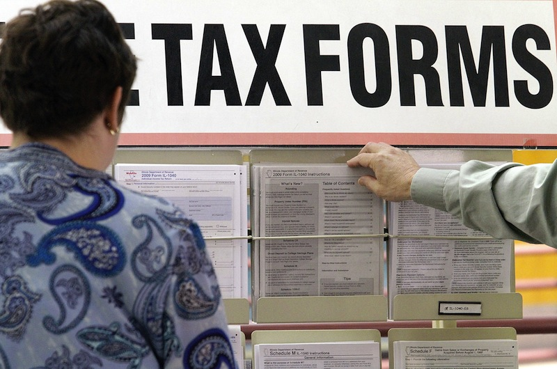 In this April 15, 2010 file photo, taxpayers sift through tax forms a government office. Maine will become one of five states to consider sweeping tax changes this year when a bipartisan coalition of lawmakers releases its highly anticipated reform plan Wednesday. (AP Photo/Seth Perlman)