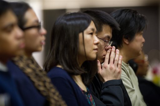 Friends, families and fellow students pack Metcalf Hall in Boston University's George Sherman Student Union on Monday for a memorial service in memory of Boston University graduate student Lu Lingzi, who was killed in the Boston Marathon bombings.