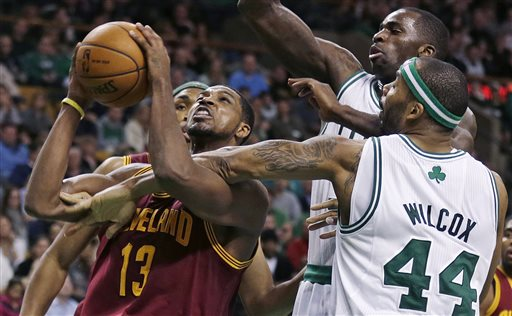 Cleveland Cavaliers forward Tristan Thompson, left, drives to the basket against Boston Celtics forward Chris Wilcox (44) during the second half of an NBA basketball game in Boston, Friday, April 5, 2013. Thompson had 29 points in the Cavaliers 97-91 win. (AP Photo/Charles Krupa)