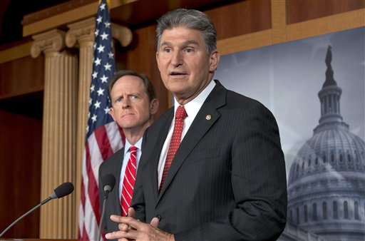 Sen. Joe Manchin, D-W.Va., right, accompanied by Sen. Patrick Toomey, R-Pa., announce that they have reached a bipartisan deal on expanding background checks to more gun buyers.