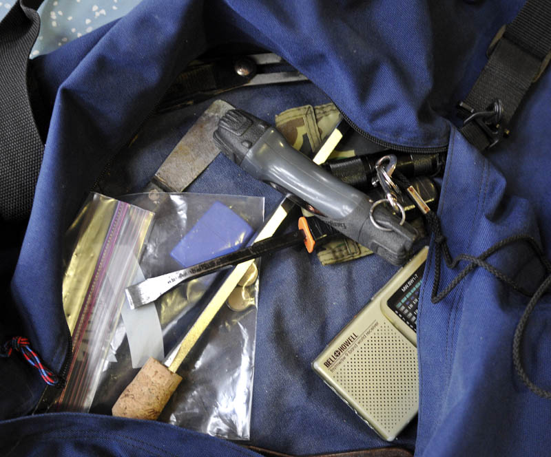 Tools recovered in a bag that Christopher Knight was carrying when he was apprehended at Pine Tree Camp in Rome Tuesday.
