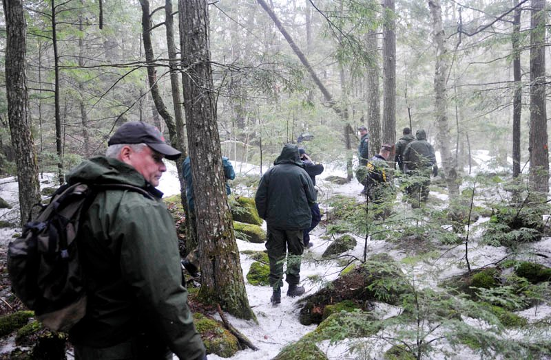 Game wardens, state police and Somerset County sheriff's deputies hike to Christopher Knight's campsite in Rome Tuesday.